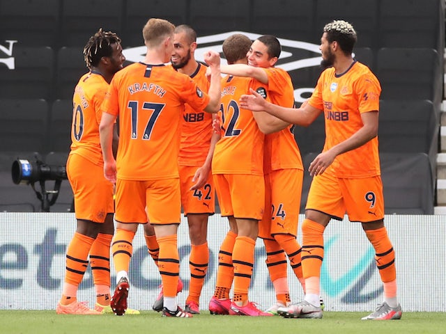 Newcastle United players celebrate scoring their third goal against Bournemouth on July 1, 2020