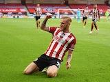 Sheffield United's Oliver McBurnie celebrates scoring against Tottenham Hotspur in the Premier League on July 2, 2020