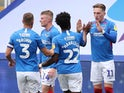 Portsmouth players celebrate scoring against Oxford United in the League One playoff semi-final on July 3, 2020