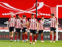 Sheffield United players celebrate scoring against Tottenham Hotspur on July 2, 2020