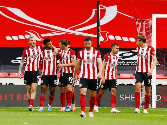 Sheffield United players celebrate scoring against Tottenham Hotspur on July 2, 2020
