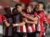 Southampton players celebrate Che Adams's goal against Manchester City on July 5, 2020
