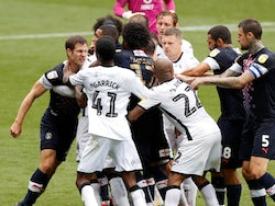 Swansea City and Luton Town players clash during a Championship clash on June 27, 2020