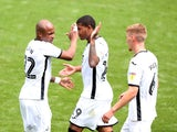 Swansea players celebrate scoring against Sheffield Wednesday on July 5, 2020