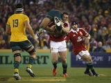 British & Irish Lions winger George North picks up Israel Folau and runs with him in 2013