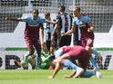 West Ham United's Tomas Soucek and Issa Diop celebrate a goal against Newcastle on July 5, 2020