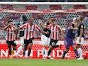 Brentford's Ethan Pinnock celebrates with teammates after his winning goal against Charlton on July 7, 2020