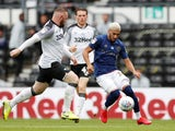 Brentford's Said Benrahma in action with Derby County's Wayne Rooney in the Championship on July 11, 2020