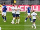 Tottenham Hotspur players celebrate an Everton own goal on July 6, 2020