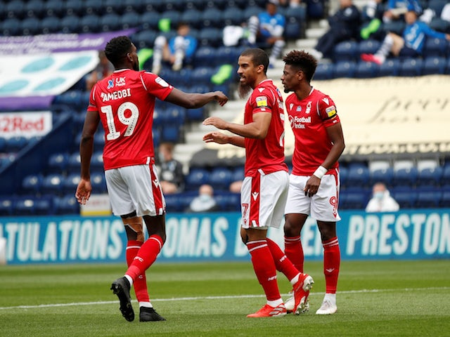 Nottingham Forest's Lewis Grabban celebrates with teammates after scoring against Preston North End on July 11, 2020