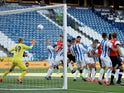 Luton Town's Sonny Bradley scores against Huddersfield Town in the Championship on July 10, 2020