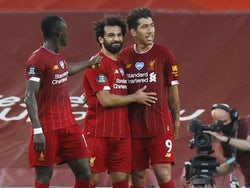 Liverpool's front three Mohamed Salah, Roberto Firmino and Sadio Mane celebrate scoring against Crystal Palace in June 2020