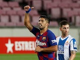 Barcelona forward Luis Suarez celebrates scoring against Espanyol on July 9, 2020