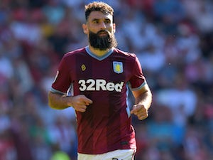Mile Jedinak announces retirement from football aged 35