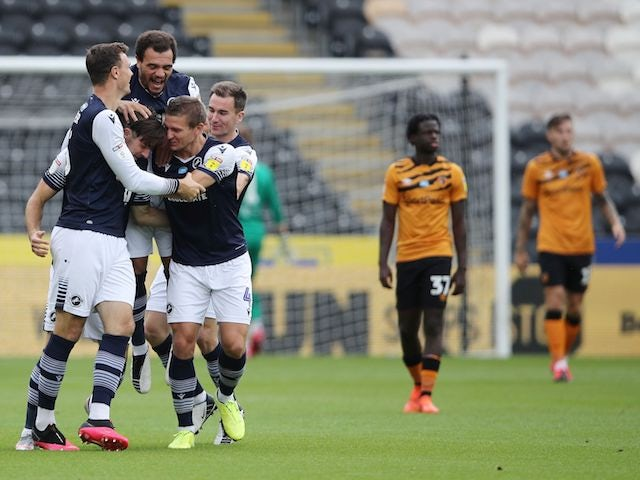 Millwall players celebrate Ryan Leonard's goal against Hull on July 11, 2020