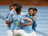 Manchester City midfielder David Silva celebrates with teammates after scoring against Newcastle on July 8, 2020