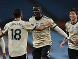 Manchester United pair Paul Pogba and Bruno Fernandes celebrate scoring against Aston Villa on July 9, 2020
