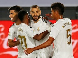 Real Madrid striker Karim Benzema celebrates with teammates after scoring against Alaves on July 10, 2020