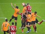 Sheffield United's John Egan scores against Wolverhampton Wanderers in the Premier League on July 8, 2020