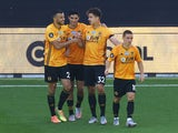 Wolverhampton Wanderers players celebrate Raul Jimenez's goal against Everton in the Premier League on July 12, 2020