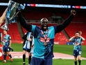 Wycombe Wanderers striker Adebayo Akinfenwa celebrates winning promotion to the Championship on July 13, 2020