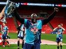 Wycombe Wanderers striker Adebayo Akinfenwa celebrates winning promotion to the Championship on July 13, 2020