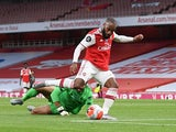 Arsenal forward Alexandre Lacazette scores against Liverpool in the Premier League on July 15, 2020