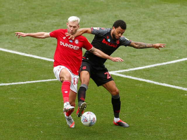 Bristol City's Andreas Weimann in action with Stoke City's Jordan Cousins in the Championship on July 15, 2020