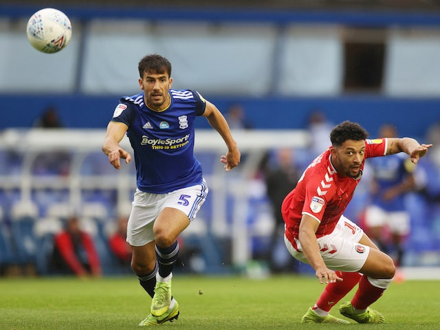 Birmingham City's Maxime Colin in action with Charlton Athletic's Macauley Bonne in the Championship on July 15, 2020