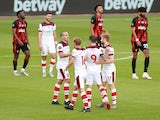 Danny Ings celebrates with his Southampton teammates after scoring against Bournemouth on July 19, 2020