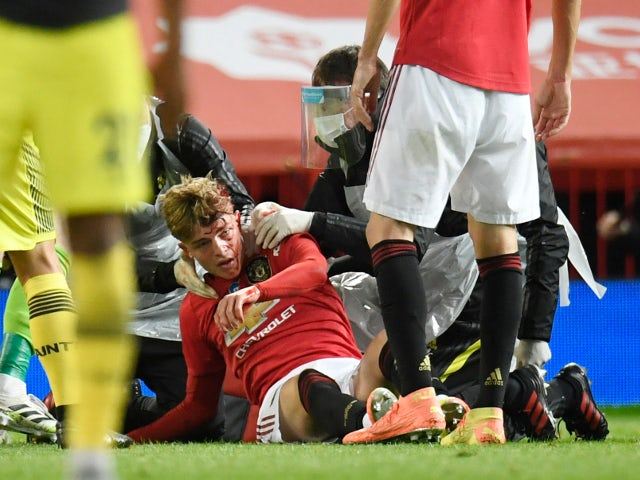 Manchester United's Brandon Williams receives treatment to a head injury in July 2020