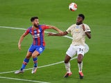 Crystal Palace's Andros Townsend in action with Manchester United's Timothy Fosu-Mensah in the Premier League on July 16, 2020