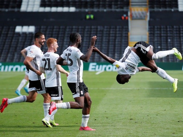 Fulham's Neeskens Kebano celebrates with teammates after scoring against Sheffield Wednesday on July 18, 2020