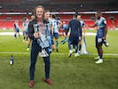 Wycombe Wanderers manager Gareth Ainsworth celebrates with the League One playoff trophy on July 13, 2020