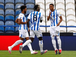 Huddersfield beat West Brom to help Leeds secure Premier League return