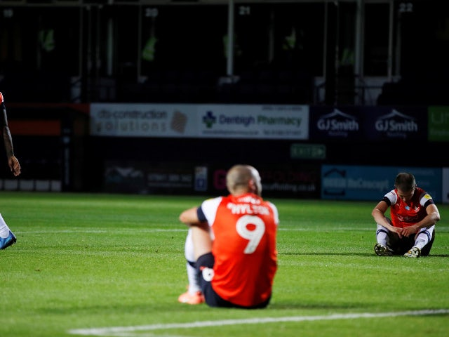 Luton players look dejected after drawing with QPR on July 14, 2020