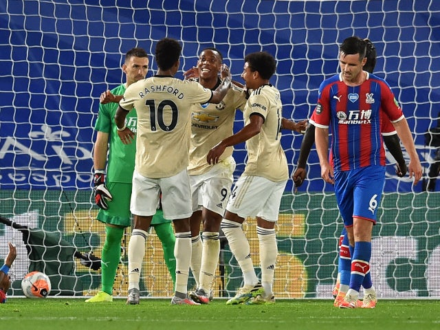 Manchester United players celebrate Anthony Martial's goal against Crystal Palace on July 16, 2020