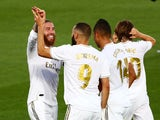Real Madrid players celebrate Karim Benzema's goal against Villarreal on July 16, 2020