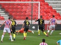 Stoke City's Lee Gregory scores against Brentford on July 18, 2020