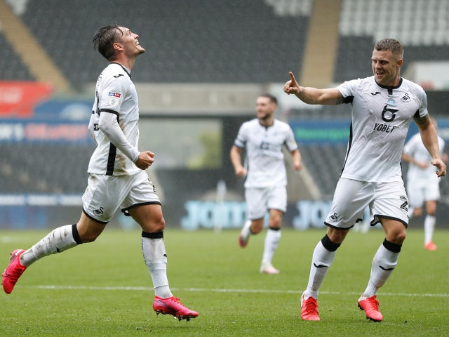 Swansea City's Connor Roberts celebrates scoring against Bristol City on July 18, 2020