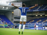 Everton's Theo Walcott celebrates scoring against Aston Villa on July 16, 2020