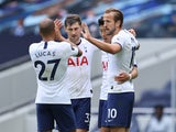Harry Kane celebrates with Tottenham Hotspur teammates after scoring against Leicester City on July 19, 2020