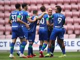 Wigan Athletic players celebrate their opening goal of the 8-0 hammering of Hull on July 14, 2020