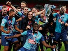 Wycombe Wanderers players celebrate winning promotion to the Championship with victory in the League One playoff final on July 13, 2020