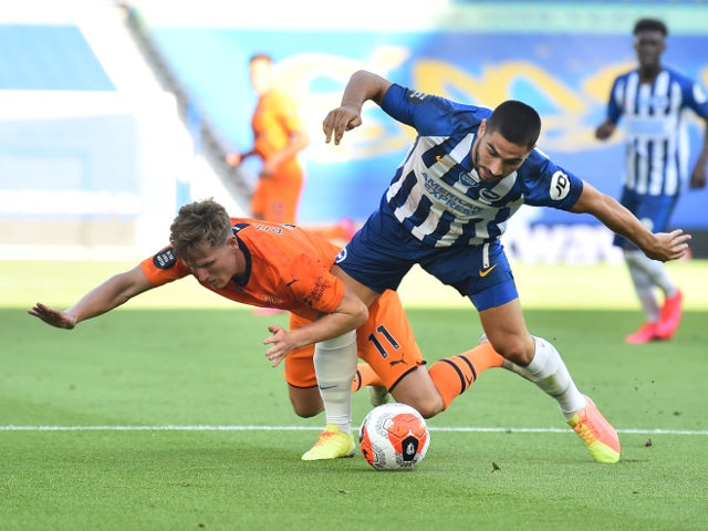 Brighton's Neal Maupay tangles with Newcastle's Matt Ritchie on July 20, 2020