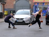 Gary pushes Sarah to safety on Coronation Street on July 29, 2020