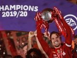 Liverpool captain Jordan Henderson lifts the Premier League trophy on July 22, 2020