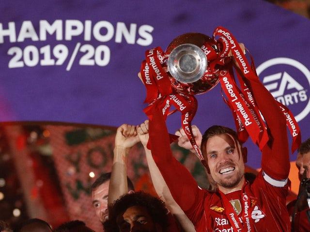Liverpool captain Jordan Henderson lifts the Premier League trophy on July 22, 2020