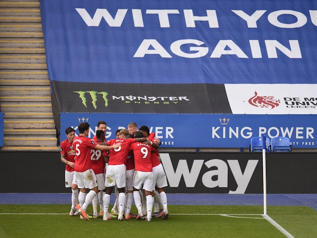 Manchester United players celebrate Bruno Fernandes's goal against Leicester City in the Premier League on July 26, 2020