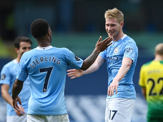 Manchester City's Kevin De Bruyne and Raheem Sterling celebrate against Norwich City in the Premier League on July 26, 2020